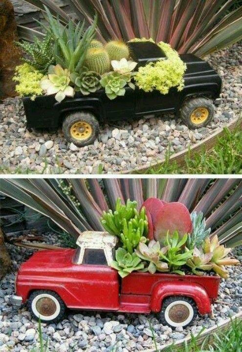 A terrarium in an old toy truck