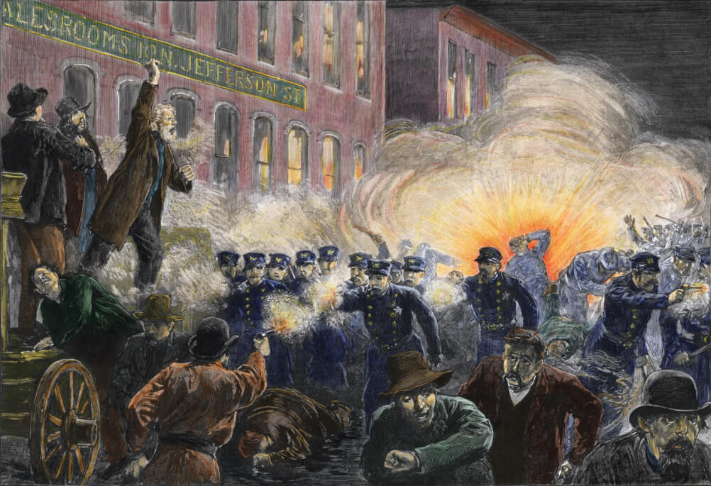 Colorized engraving shows a composit scene from the Haymarket Riot, where an initially peaceful labor protester devolved into a full-scale riot following the detonation of a bomb thrown by protestors (seen in the background) and the police response of indiscriminate firing into the largely unarmed (despite this picture's contrary view) crowd, Chicago, Illinois, May 4, 1886. (Photo by Stock Montage/Getty Images)