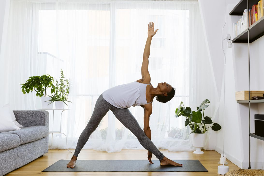 A woman doing gentle exercise yoga in the living room