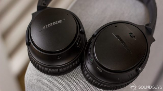 Bose QuietComfort 35 II image on a gray couch arm.