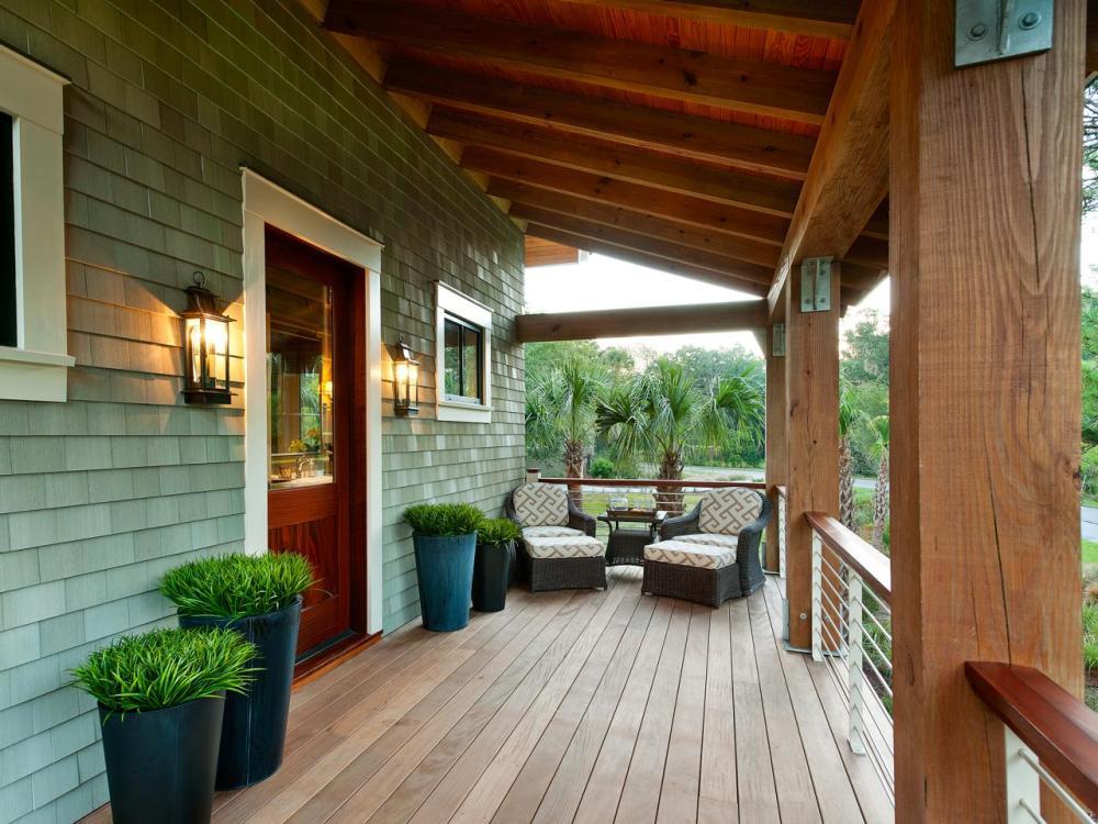 model teras rumah minimalis dengan aksesoris tanaman hias pot besar
