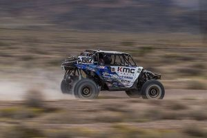 Jeremiah Staggs blasts around a corner at BITD's Silver State 150