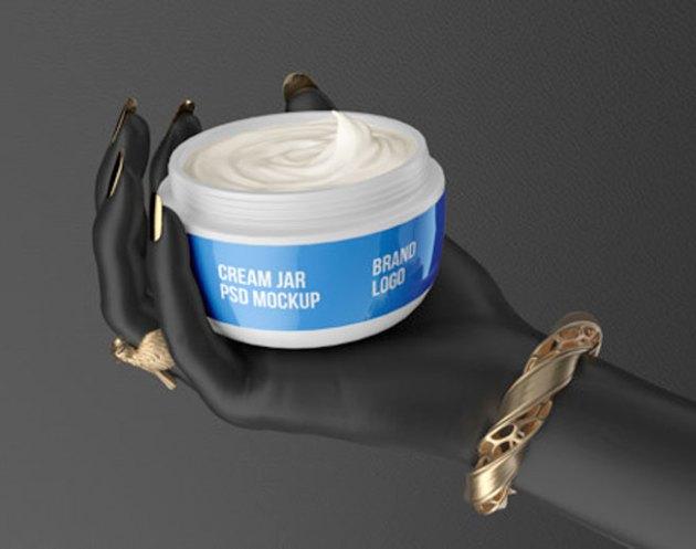 Cosmetic Jar White Cream On Black Hand PSD Mockup