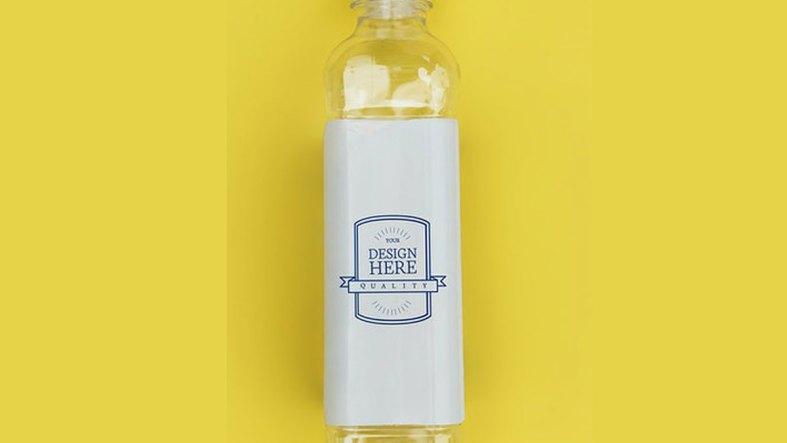 Mockup design space on water bottle label - 296015