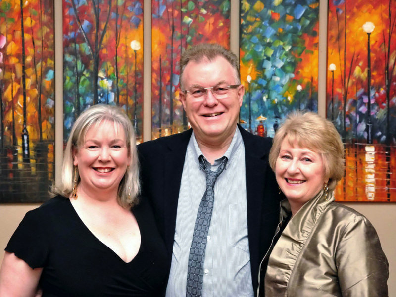 John with his wife (shown right) and a family friend (shown left).