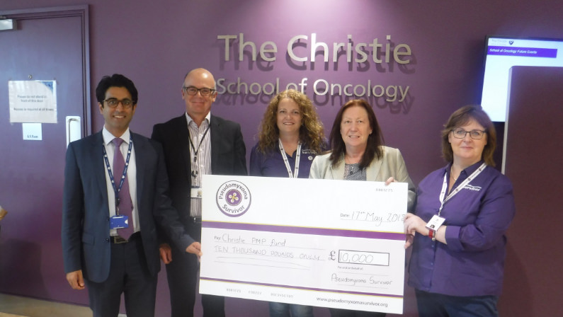 Susan and Angela present the peritoneal surface malignancy team at the Christie with a cheque
