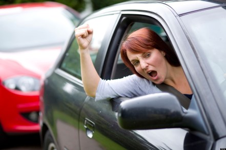 Woman gesturing out of car window