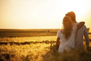Loving couple in wheat field.