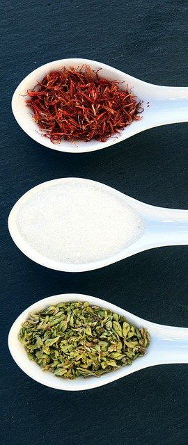 3 different spices on spoons