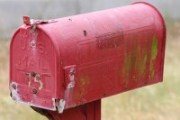 an old red US Mailbox