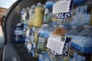 A trunk full of water donations, with PSDP cards and hand-drawn hearts.