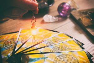 pendulum dowsing over tarot cards