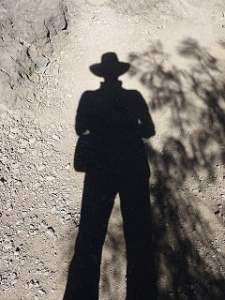 shadow hat man