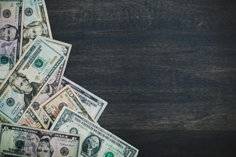 bills on woodgrain