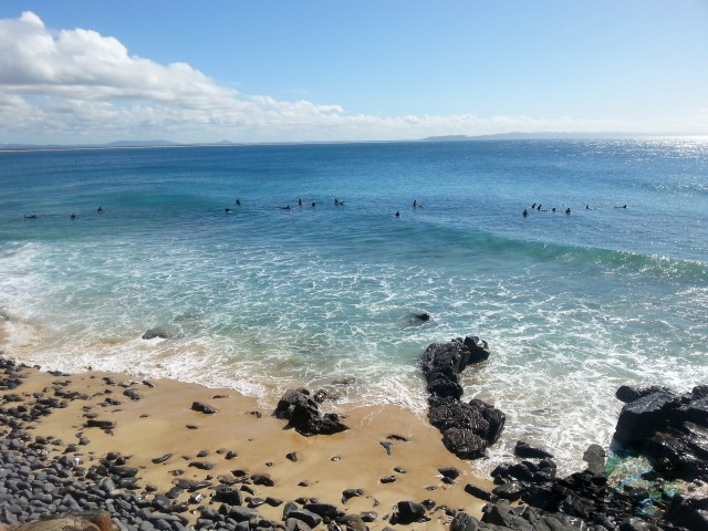 Surfers Enjoying The Waves in Agnes Water