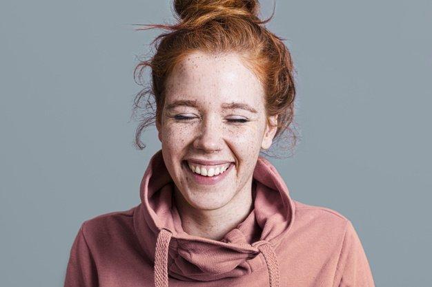 happy woman wearing jumper