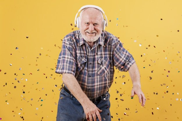 happy old man with confetti