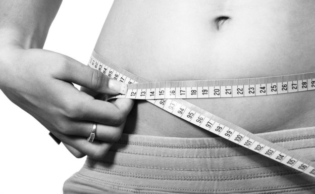 measuring the waist using a tape measure