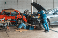mechanics fixing a car