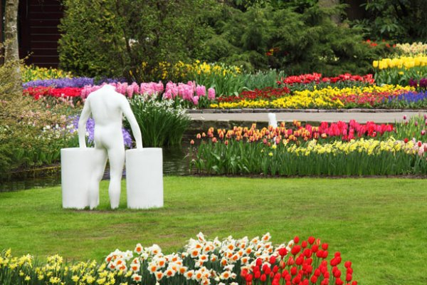 statue in flower garden free stock