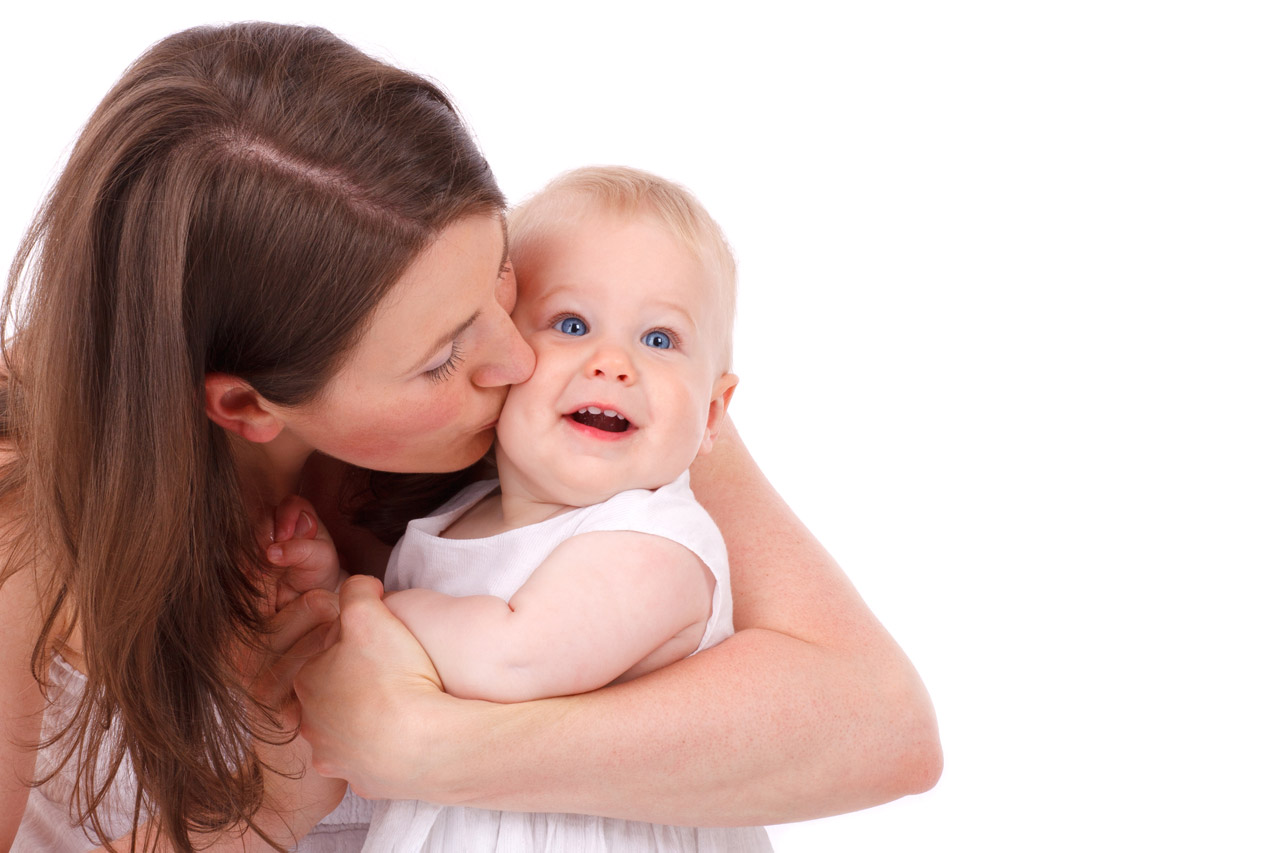 mother kissing baby free stock photo - public domain pictures