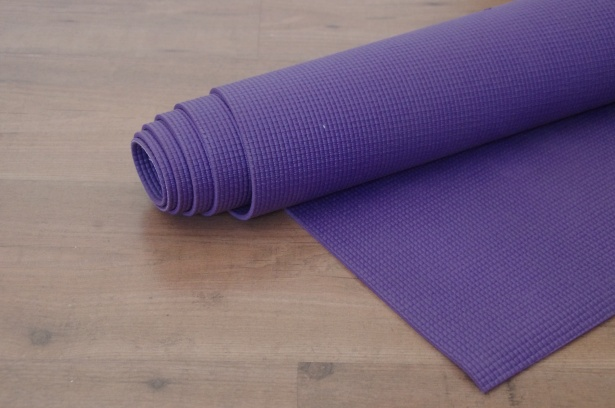 yoga mat on wooden