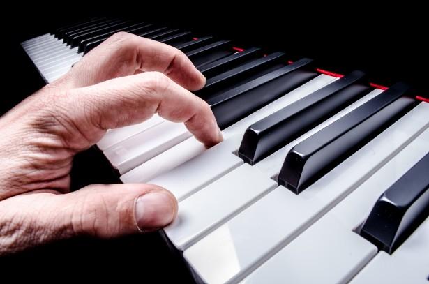 Hand Playing On Digital Piano