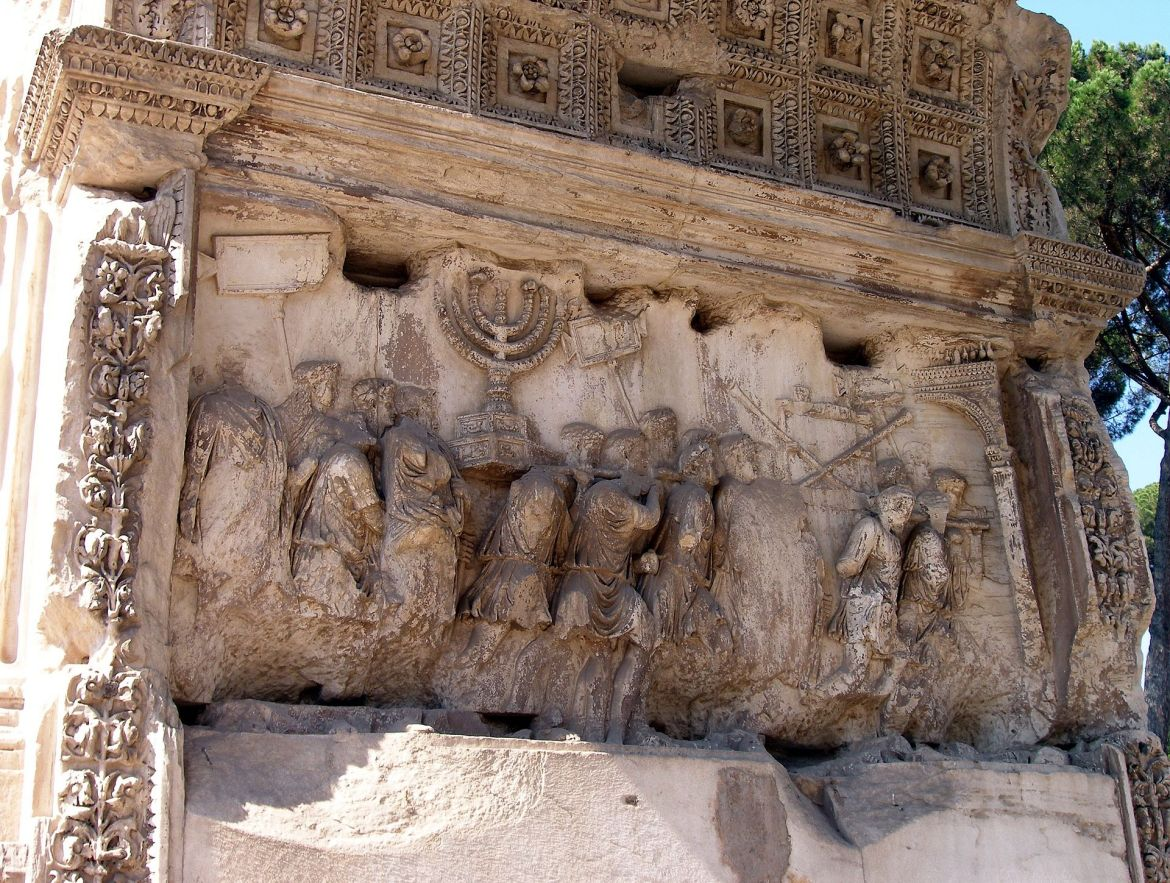 Close-up relief of the Arch of Titus in Rome, depicting the sack of Jerusalem in 70 CE.