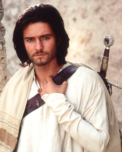 Orlando bloom with a sword strapped to his back and a prayer shawl on his shoulder, from the 2005 film Kingdom of Heaven.