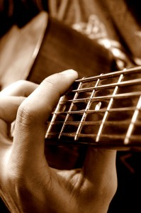 Playing the guitar © seriousbri | Flickr