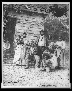 Family of African American slaves on Smith's Plantation, Beaufort, South Carolina, circa 1862. © Timothy H. O'Sullivan | learnnc.org