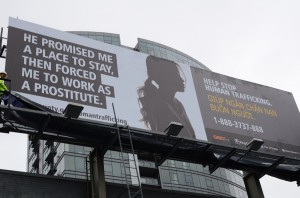 Bilingual human trafficking awareness billboard © Mayor Mike McGinn | Flickr