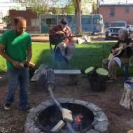 David Gouge and James Smith playing with Tim working the fire pit.