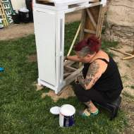 Denise painting the wood stacker