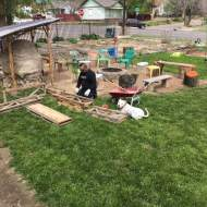 Joseph builds a wood stacker with Kimbo watching