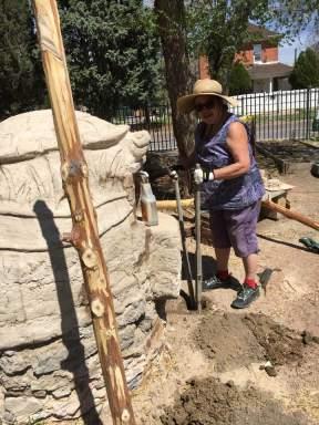 May Avina digs the post holes.