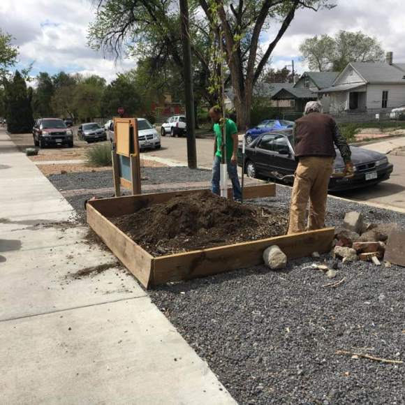 Tim & Jimi making a new planter box out front.