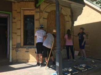 volunteers start scraping