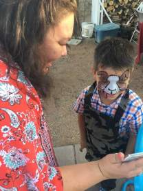 Donna shows Estefan his painted face in her phone