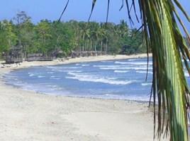 Photo: lazy waves of Honda Bay grace sandy beach before treeline of Puerto Beach Resort at Palawan, Philippines