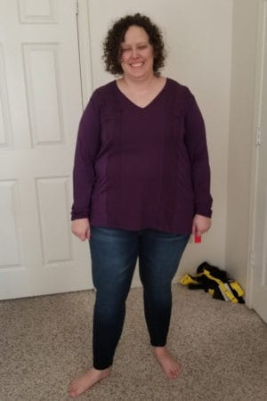purple shirt and jeans