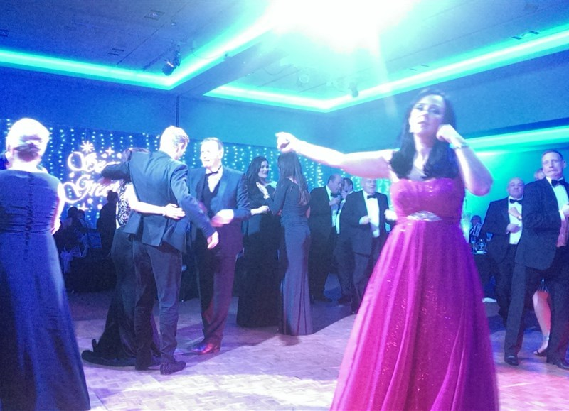 Pulse function band Glasgow & Ayrshire at St Andrew's Sporting Club Winter Ball in the Radisson Blu Hotel in Glasgow people dancing on busy dance floor
