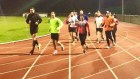 runners on running track under floodlights