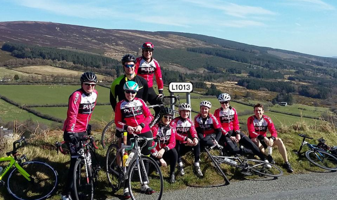 members of a Pulse group cycle pictured by the side of the road in the Wicklow Mountains.
