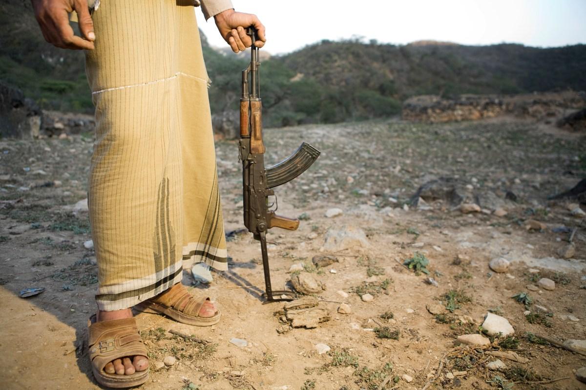 Yemeni man holding Kalashnikov used to hunt wildlife, Hawf Protected Area, Yemen