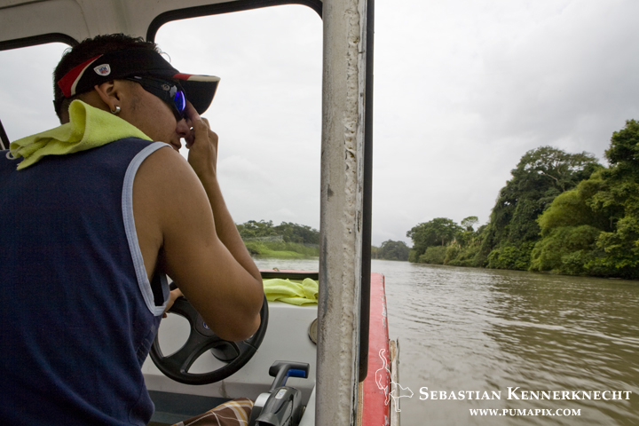 Jorge Avella driving down channel, Tortuguero National Park, Costa Rica