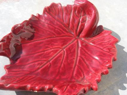Red ceramic Vallauris pottery wine vine leaf at PumpjackPiddlewick