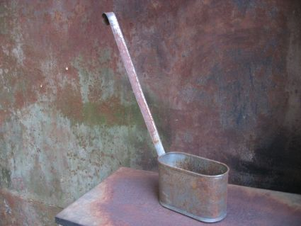 Water barrel ladle at PumpjackPiddlewick