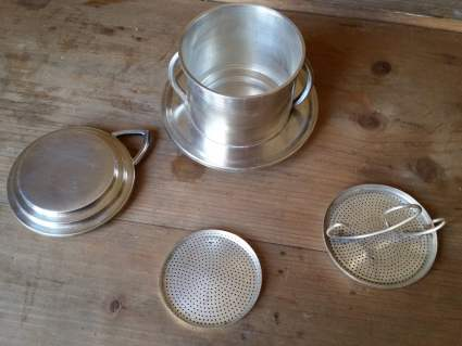 An old single cup coffee filter from France is a debelloire