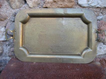 Large brass serving tray at PumpjackPiddlewick